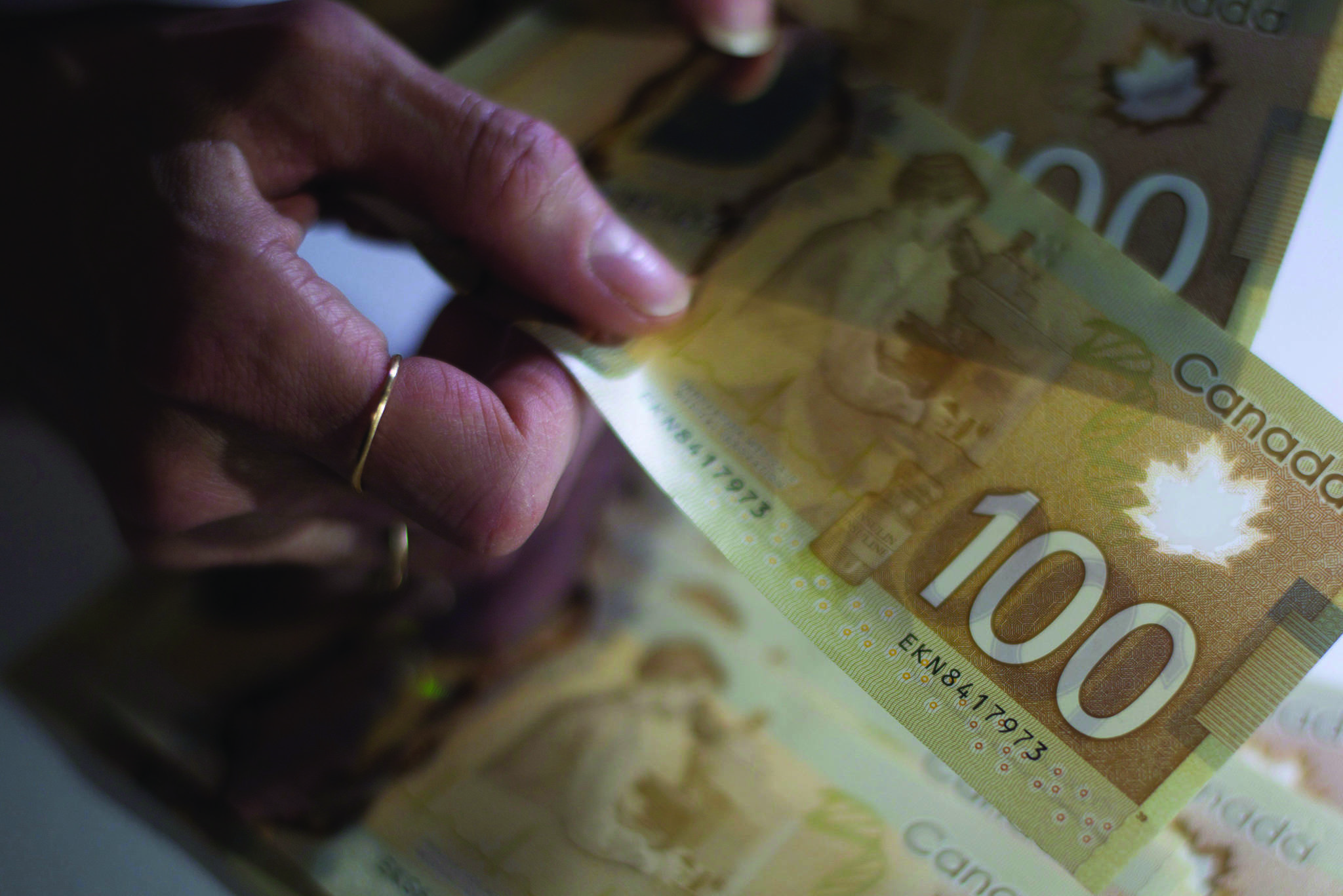 Canadians saw their national wealth drop in the last quarter of 2018. The 'national wealth' of a single Canadian fell from $304,085 to $296,933. THE CANADIAN PRESS/Graeme Roy